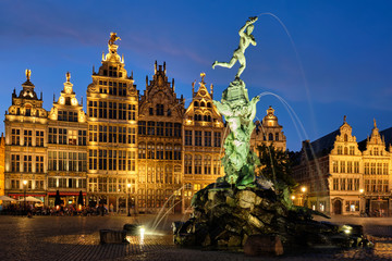 Poster Antwerp Antwerp Grote Markt with famous Brabo statue and fountain at night, Belgium