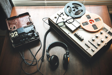 Reel tape recorder for wiretapping . Field telephone set USSR is lying nearby.  KGB spying conversations. - fototapety na wymiar