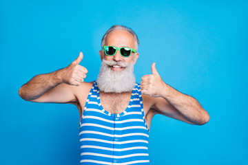 Close-up portrait of his he nice attractive content cheerful cheery glad gray-haired man showing two double thumbup great resort spa ad isolated over bright vivid shine turquoise blue background Papier Peint