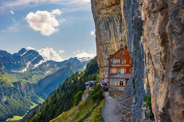 Swiss Alps and a restaurant under a cliff on mountain Ebenalp in Switzerland Fototapete