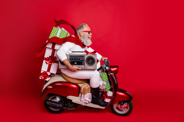 Profile side view of his he nice attractive cheerful cheery funky bearded gray-haired man carrying cool desirable purchase things eve noel celebration isolated on bright vivid shine red background Fototapete