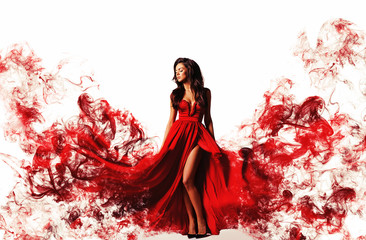 gorgeous woman in a fantasy red dress like a smoke. Studio picture, white background