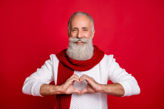 Close-up portrait of his he nice attractive confident cheerful cheery gray-haired man showing heart shape healthcare medicine isolated over bright vivid shine red background
