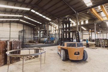 forklift in factory nobody workplace in wide angle image