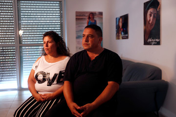 Shir and Herzl Hajaj, whose daughter was killed in a 2017 Palestinian truck ramming attack in Jerusalem, during an interview with Reuters in their home in the Israeli settlement of Maale Adumim, in the occupied West Bank