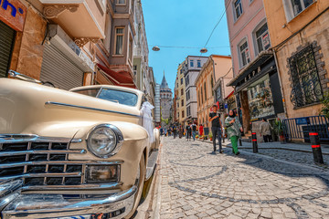 Wall Murals Caribbean 05/26/2019 Istambul, the view on the passage of Galata Tower and the retro car Cadillac 1947, the most touristy and famous landmark in the European side of Istanbul