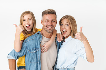 Photo of excited caucasian family woman and man with little girl smiling and showing thumbs up