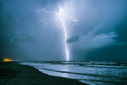 Bright lightning bolt strikes in the North Sea during a summer thunderstorm