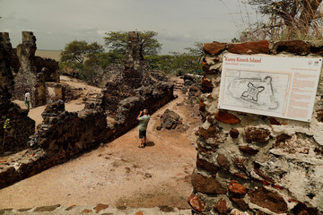 Tourist takes a photograph of ruins on the Kunta Kinte island in the Gambia River, Jufureh near Albreda