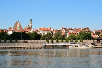 Scenic view of the Old Town - historic quarter of Warsaw with Royal Castle and red roof tenements...