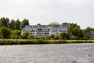 Generating electrical energy through solar panels on the roof of 6 houses in the Merenwijk in Leiden the Netherlands.