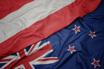 Wall Murals Northern Europe waving colorful flag of new zealand and national flag of austria.