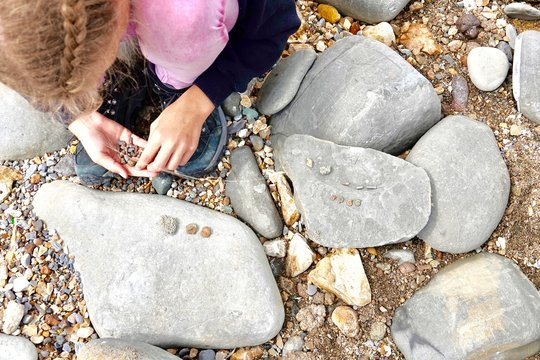 Fossil hunting at Charmouth beach Dorset England.