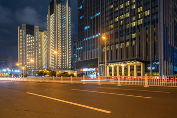 Fotomurales - Office buildings and highways at night in the financial center, qingdao, China