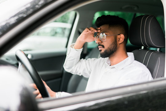 Tired man want sleeps while driving car in traffic