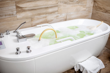 Hydromassage tub filled with water ready for use in the SPA room