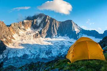 Hiking tent in the italian alps Wall mural