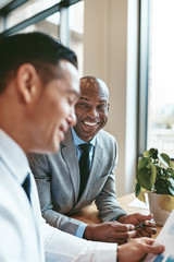 Smiling African American businessman working with a colleague