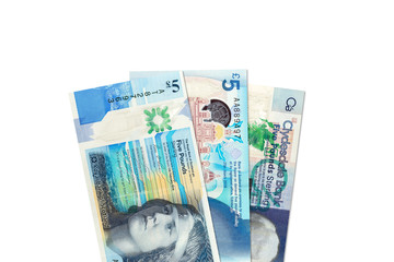 three different 5 Pounds Sterling banknotes issued by Scottish Banks with copyspace