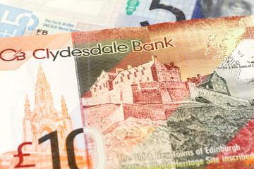 detail of 5 and 10 Pounds Sterling notes issued by Clydesdale Bank PLC