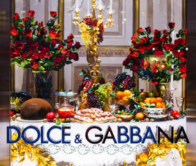 New York, New York, USA - December 11, 2015:  Dolce & Gabbana display window on Fifth Ave. Manhattan. Focus is on the Dolce & Gabbana lettering.