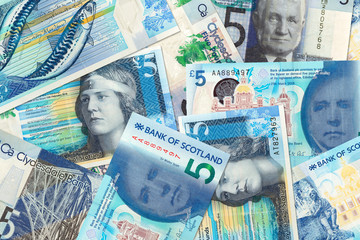 some different 5 Pounds Sterling banknotes issued by Scottish Banks