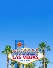Foto op Canvas Las Vegas Famous Las Vegas sign on bright sunny day with blue sky background and copy space