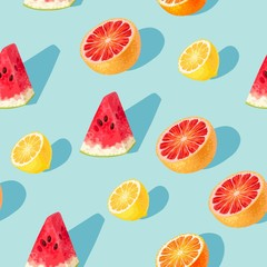 Seamless pattern with grapefruit and lemon slices