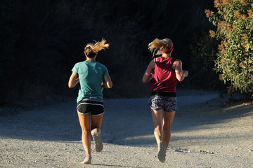 Women go for a sunrise trail run in the Santa Monica mountains in Los Angeles