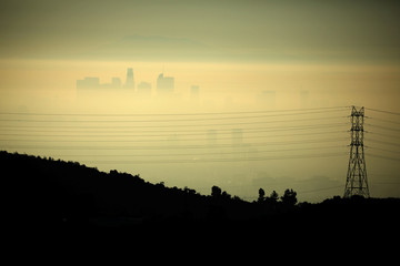 Downtown Los Angeles is seen behind an electricity pylon through the morning marine layer in Los Angeles