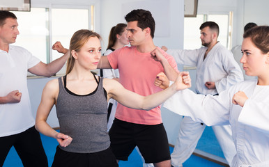 Adults training at karate class