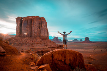 Recess Fitting Magenta A boy in a white T-shirt in the sunset inside Monument Valley National Park. Utah