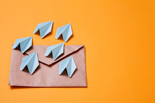 Concept for sending e-mails and e-commerce business. Email marketing. Paper planes flying out of the envelope