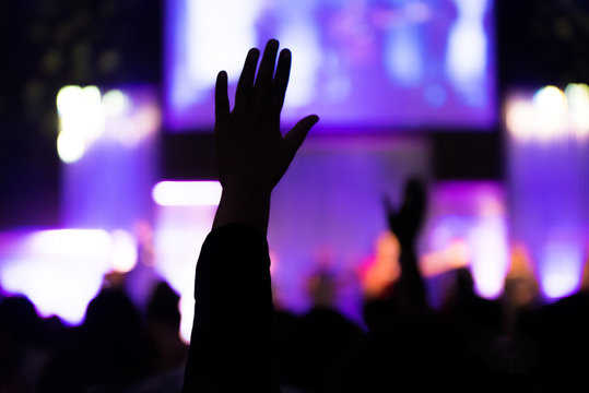 Silhouette of Human Hands Raised at Church