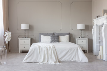 New york style bedroom interior with symmetric design, copy space on empty grey wall Fotobehang