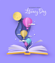 Fototapeta Literacy Day open book papercut hot air balloon obraz