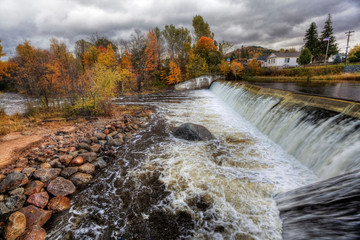 Dam and autumn foliage in Wilmington, New York