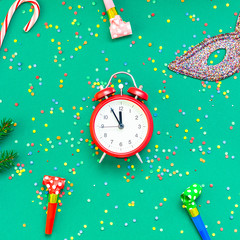 Christmas pattern flat lay with red alarm clock