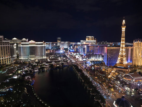 Night view of the Bellagio fountain pond, Caesars Palace and Paris Resorts on October 6, 2011 in Las Vegas, Nevada, USA.