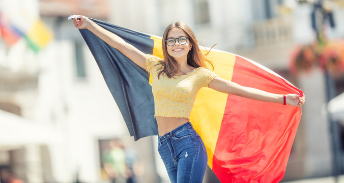 Attractive happy young girl with the Belgian flag