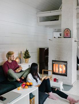 Loving people enjoying fire at home