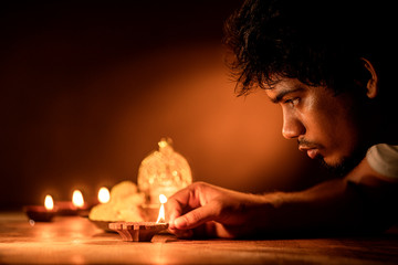 Indian young man celebrating Diwali