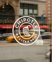 New York, New York, USA - July 3, 2016: The logo on a Chipotle Mexican Grill restaurant window in Manhattan.