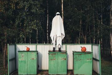 Ghost standing on garbage bin