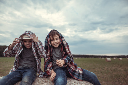 Portrait of a little boy on a haystack