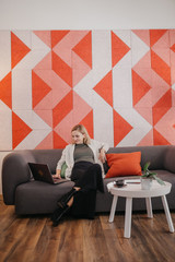 Young business woman working in a co-working environment