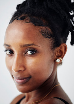 Portrait of a beautiful young woman with braids making eye contact