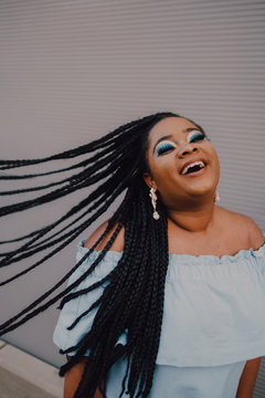 Smiling woman with braids
