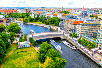 Skyline aerial view of Spree River and Museum island in Berlin city, Germany. Berlin touristic tour boats on the river. View from Berliner Dom