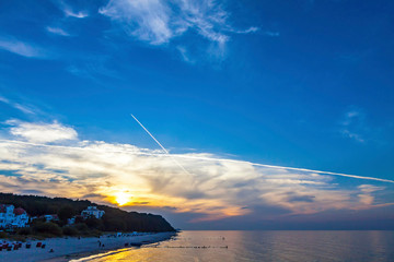 Sunset over baltic seacoat in Heringsdorf, Germany. Heringsdorf is a municipality and a popular seaside resort town on Usedom Island in Western Pomerania. Also known as Kaiserbad (Eng: Imperial Spa)